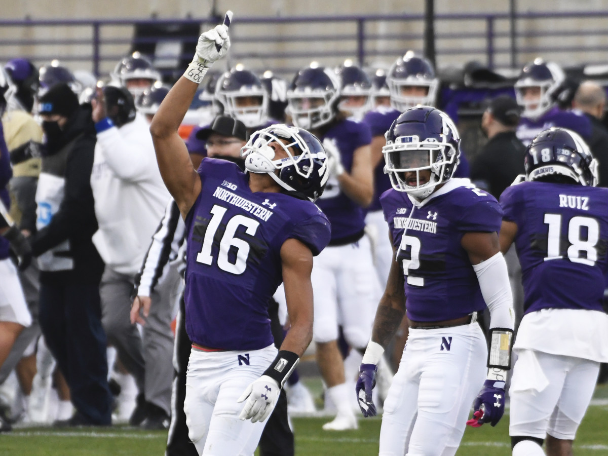 Northwestern Wildcats defensive back Brandon Joseph (16) gestures after intercepting against the Wisconsin Badgers during the first half at Ryan Field