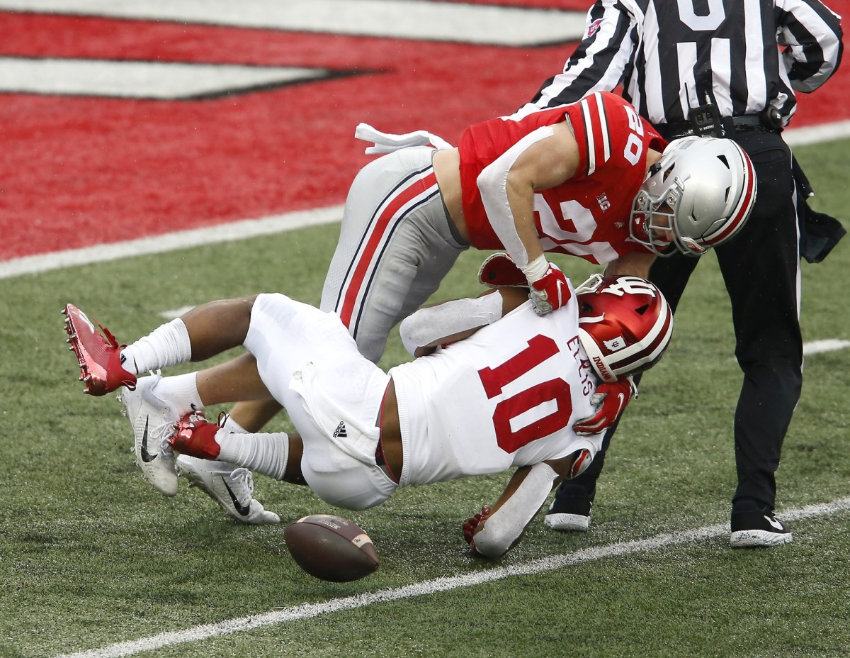 Indiana running back David Ellis (10) fumbles while after being stripped by Ohio State linebacker Pete Werner (20) during the second quarter at Ohio Stadium. (Joseph Maiorana/USA TODAY Sports)