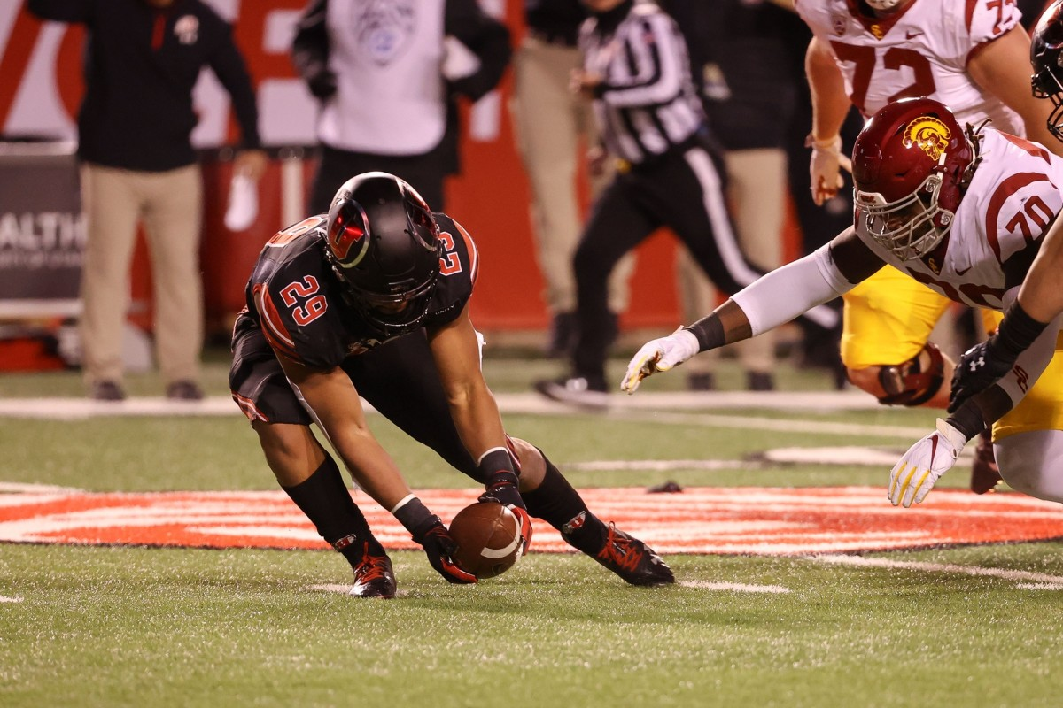 Nov 21, 2020; Salt Lake City, Utah, USA; Utah Utes linebacker Nephi Sewell (29) picks up the fumble and runs to the end zone against the USC Trojans at Rice-Eccles Stadium.