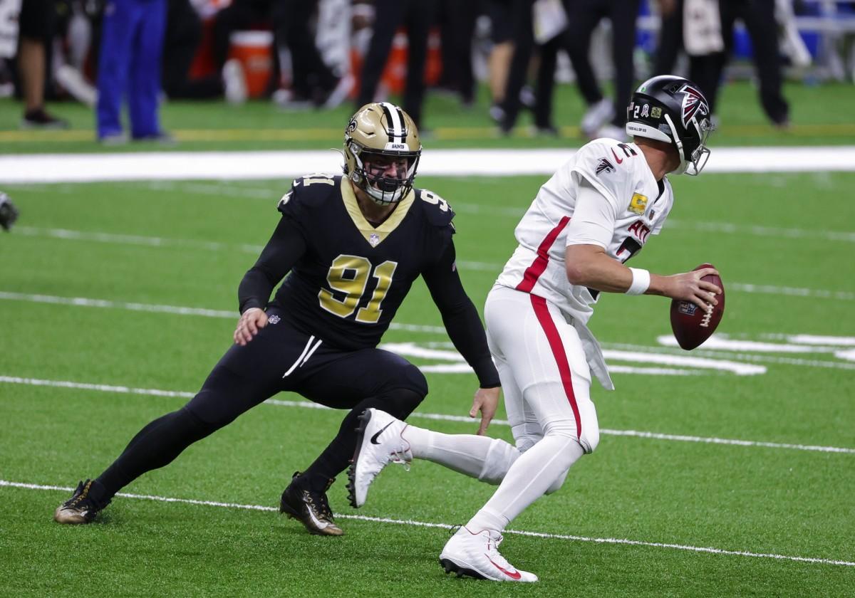 Saints DE Trey Hendrickson chases down Falcons QB Matt Ryan.