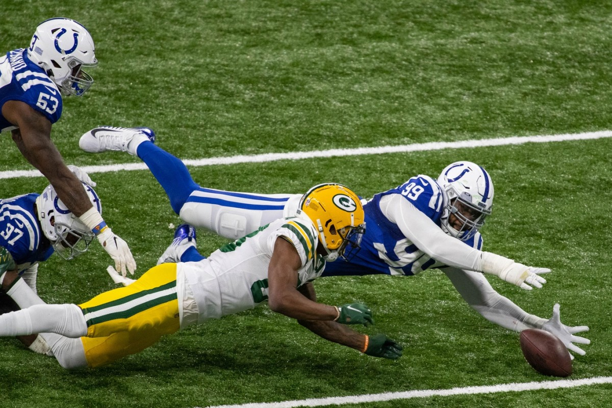 Indianapolis Colts defensive tackle DeForest Buckner falls on a fumble in overtime to set up a game-winning field goal in a 34-31 home win Sunday over the Green Bay Packers.