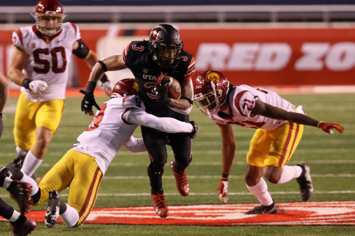 Nov 21, 2020; Salt Lake City, Utah, USA; Utah Utes wide receiver Tyrone Young-Smith (3) tries to run through the arms of USC Trojans safety Greg Johnson (9) during the second half at Rice-Eccles Stadium. USC Trojans won 33