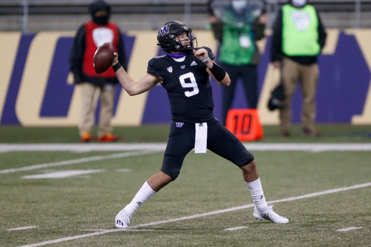 Nov 21, 2020; Seattle, Washington, USA; Washington Huskies quarterback Dylan Morris (9) throws a pass against the Arizona Wildcats during the second quarter at Alaska Airlines Field at Husky Stadium.