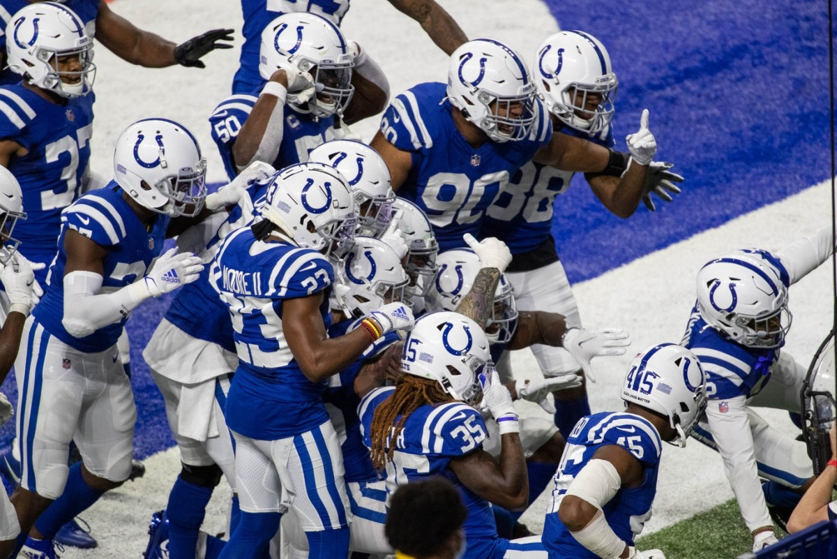 The Indianapolis Colts defense celebrates after coming up with a turnover in Sunday's 34-31 overtime home win over the Green Bay Packers.