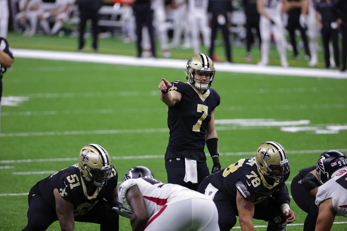 Nov 22, 2020; New Orleans, Louisiana, USA; New Orleans Saints quarterback Taysom Hill (7) at the line against the Atlanta Falcons during the second half at the Mercedes-Benz Superdome. Mandatory Credit: Derick E. Hingle-USA TODAY Sports