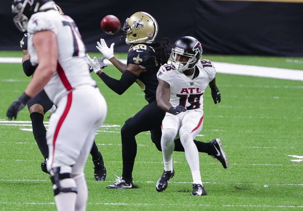 Nov 22, 2020; New Orleans, Louisiana, USA; New Orleans Saints cornerback Janoris Jenkins (20) intercepts a pass intended for Atlanta Falcons wide receiver Calvin Ridley (18) during the second half at the Mercedes-Benz Superdome. Mandatory Credit: Derick E. Hingle-USA TODAY