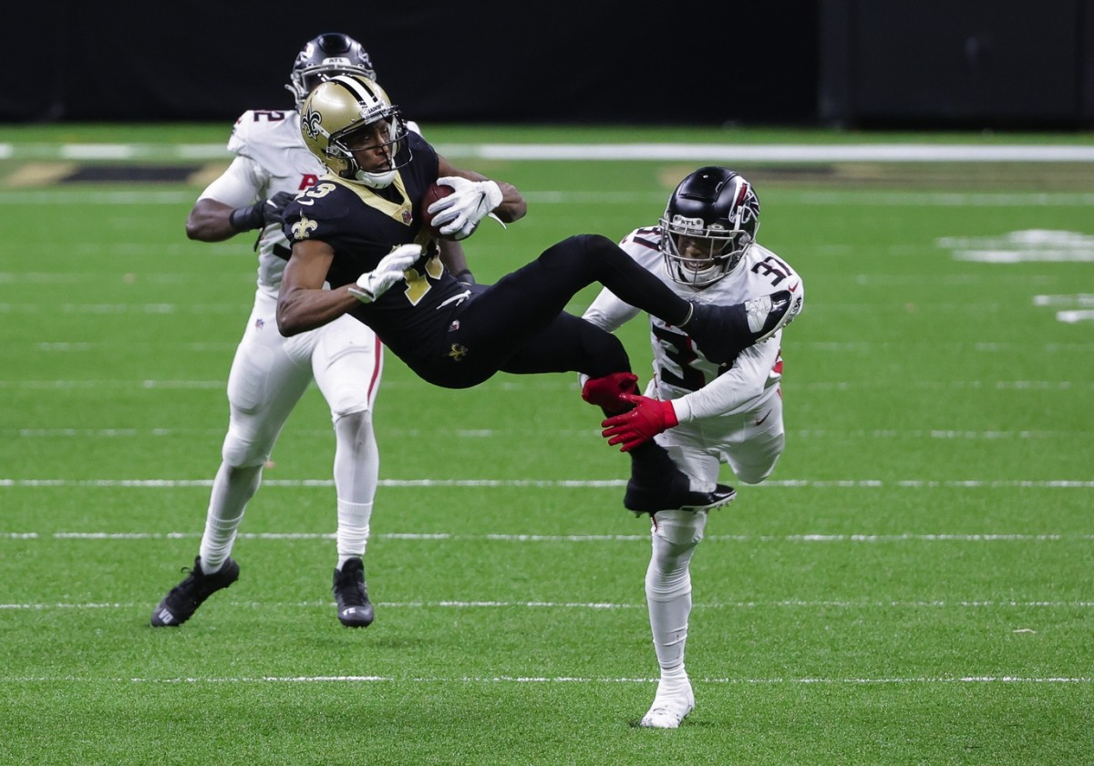 Nov 22, 2020; New Orleans, Louisiana, USA; New Orleans Saints wide receiver Michael Thomas (13) catches a pass over Atlanta Falcons free safety Ricardo Allen (37) during the second half at the Mercedes-Benz Superdome. Mandatory Credit: Derick E. Hingle-USA TODAY