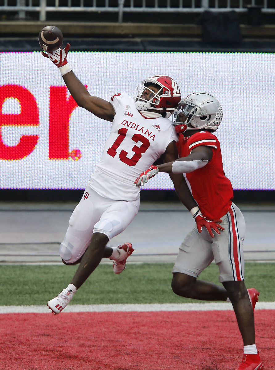 Indiana Hoosiers wide receiver Miles Marshall (13) goes up for the pass while defended by Ohio State Buckeyes cornerback Sevyn Banks (7)during the first quarter at Ohio Stadium.