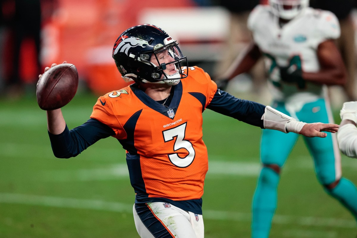 Denver Broncos quarterback Drew Lock (3) looks to pass in the fourth quarter against the Miami Dolphins at Empower Field at Mile High.