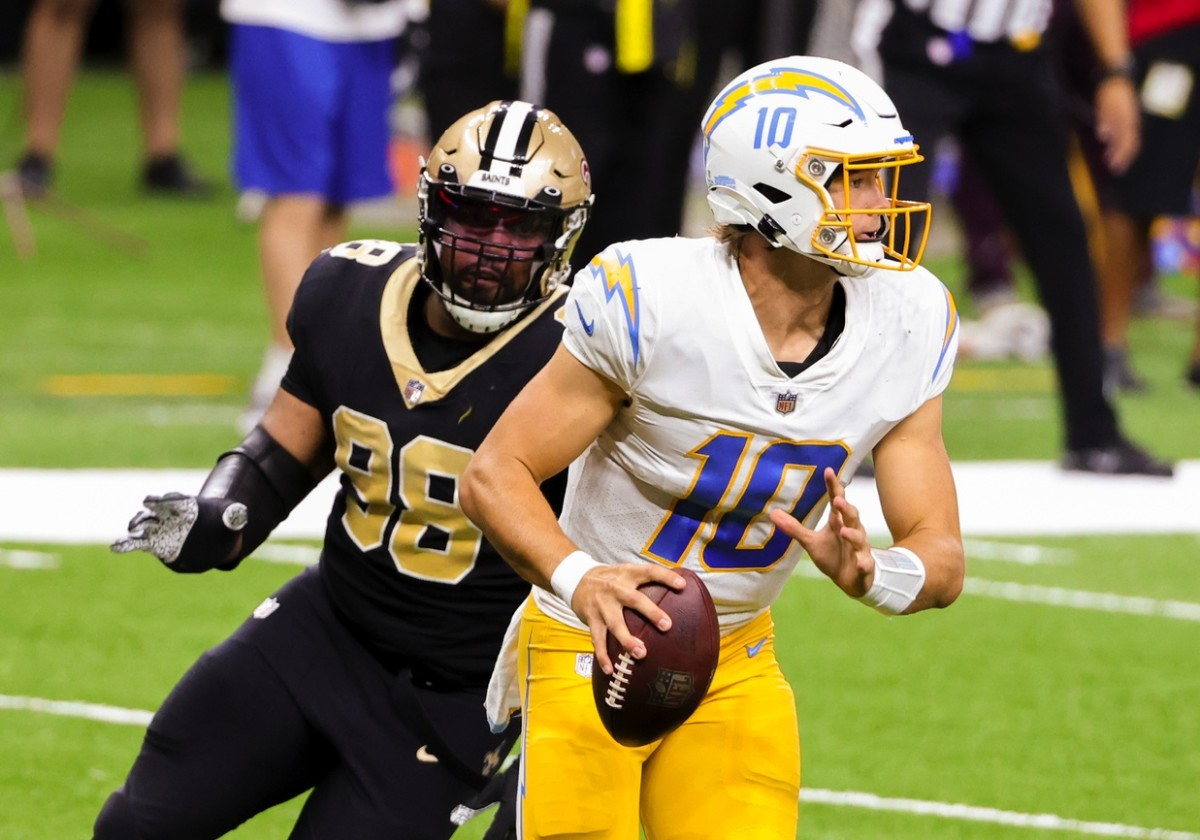 Oct 12, 2020; New Orleans, Louisiana, USA; Los Angeles Chargers quarterback Justin Herbert (10) looks to throw as New Orleans Saints defensive tackle Sheldon Rankins (98) pressures during the second half at the Mercedes-Benz Superdome. Mandatory Credit: Derick E. Hingle-USA TODAY Sports