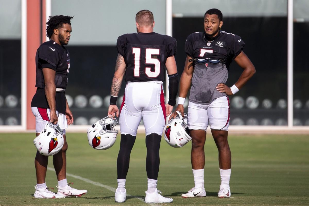 Arizona Cardinals quarterbacks Kyler Murray (1), Chris Streveler (15), and Brett Hundley (7) talk during practice on Sept. 17, 2020, at Dignity Health Arizona Cardinals Training Center in Tempe, Ariz.