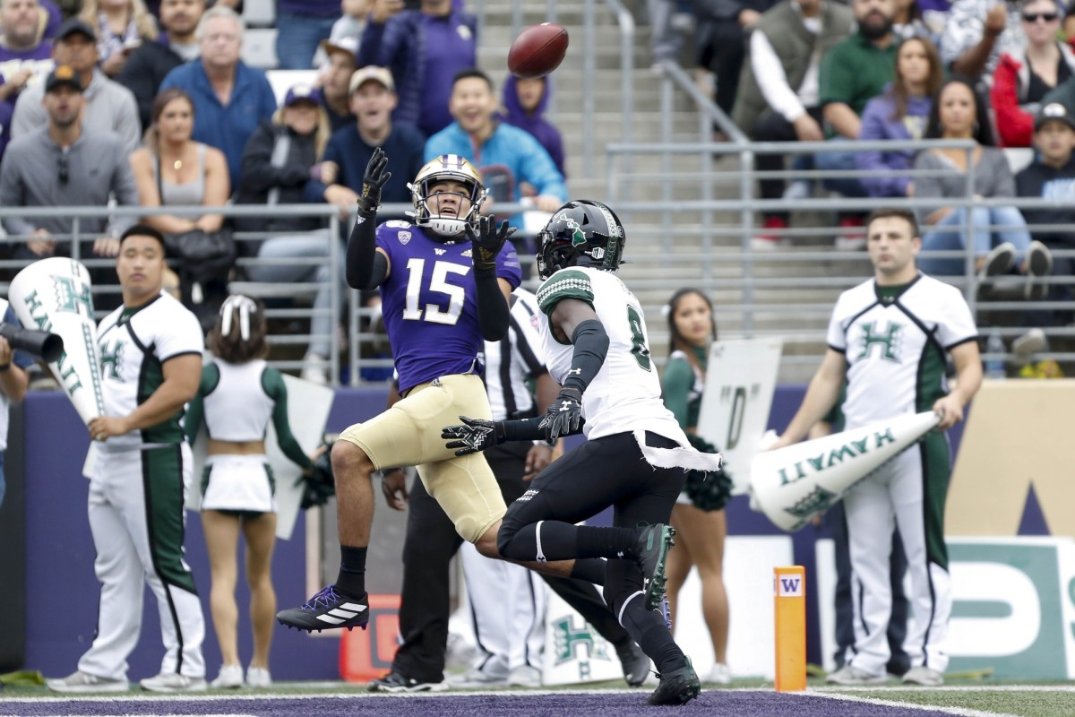 Sep 14, 2019; Seattle, WA, USA; Washington Huskies wide receiver Puka Nacua (15) catches a 28-yard touchdown pass over Hawaii Warriors defensive back Eugene Ford (8) during the first quarter at Husky Stadium.
