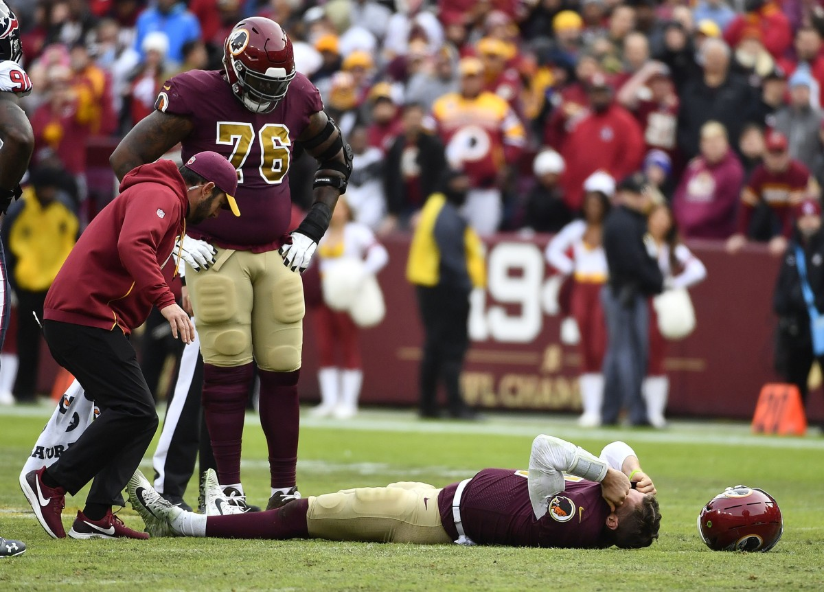 Nov 18, 2018; Landover, MD, USA; Washington Redskins quarterback Alex Smith (11) reacts after breaking his leg in the second half against the Houston Texans during the second half at FedEx Field.
