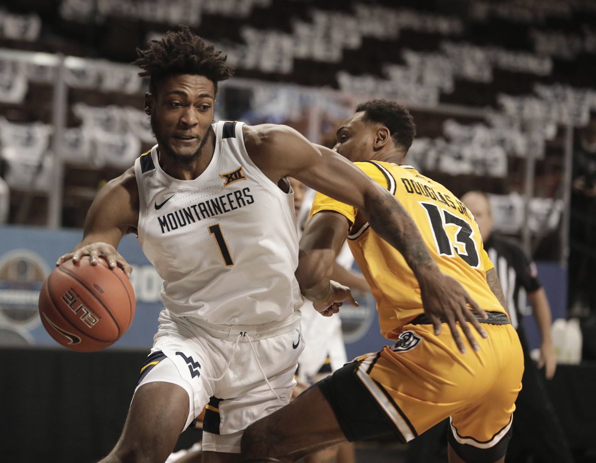SIOUX FALLS, SD - NOVEMBER 26: Derek Culver #1 of the West Virginia Mountaineers drives around \Corey Douglas Jr. #13 of the Virginia Commonwealth Rams during the Bad Boy Mowers Crossover Classic at the Sanford Pentagon in Sioux Falls, SD.
