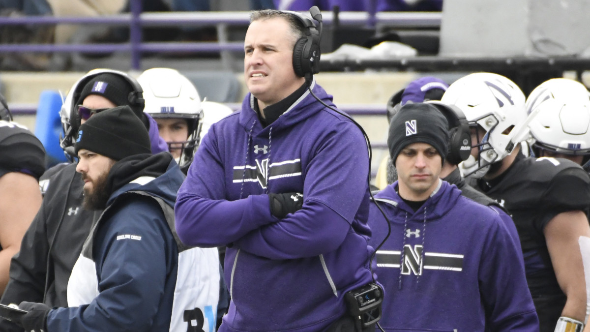 Northwestern Wildcats head coach Pat Fitzgerald stands on the sidelines in a game against the Minnesota Golden Gophers during the first half at Ryan Field.