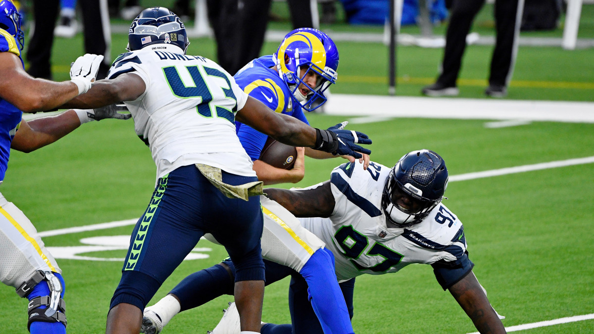 Los Angeles Rams quarterback Jared Goff (16) braces for the sack by Seattle Seahawks defensive end Carlos Dunlap (43) during the second half at SoFi Stadium.