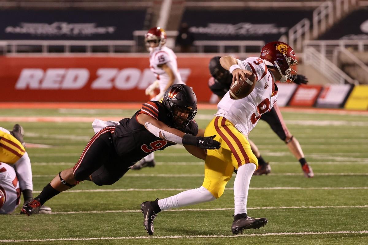 Nov 21, 2020; Salt Lake City, Utah, USA; USC Trojans quarterback Kedon Slovis (9) tries to run away from Utah Utes linebacker Sione Fotu (9) during the second half at Rice-Eccles Stadium. USC Trojans won 33-17.