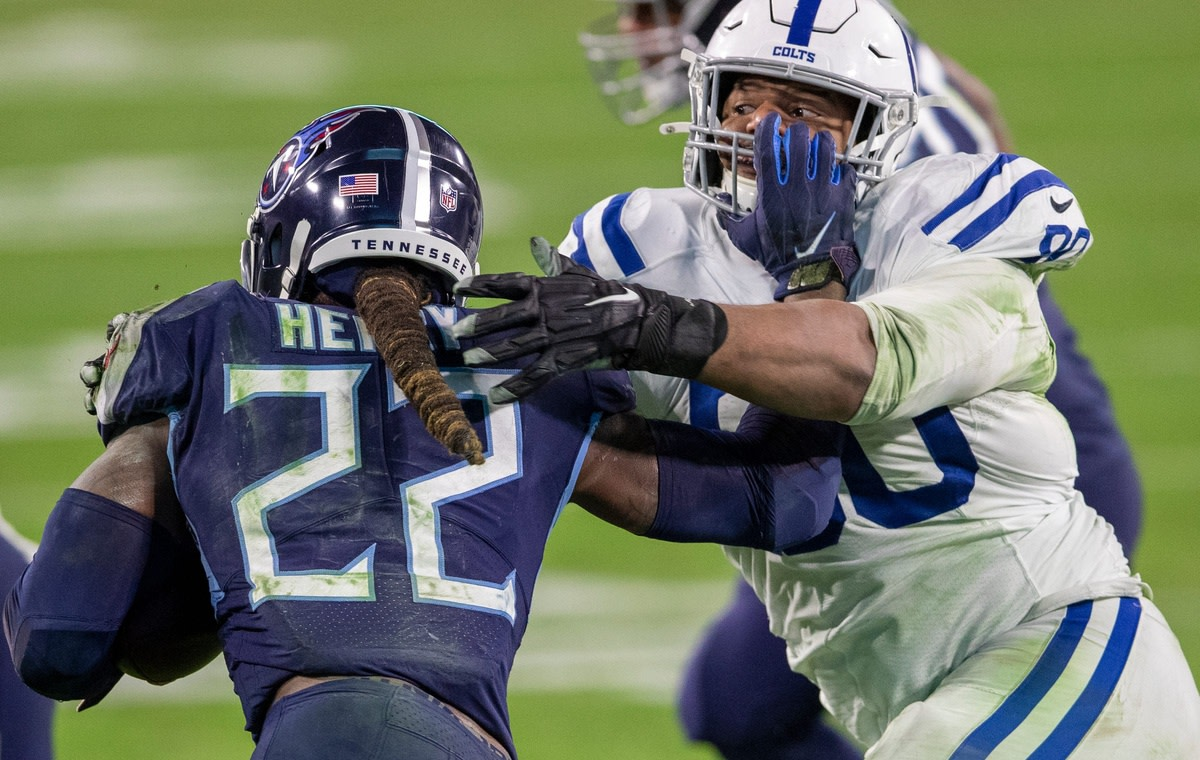 Indianapolis Colts defensive tackle Grover Stewart (90) tries to slow down Tennessee Titans running back Derrick Henry.