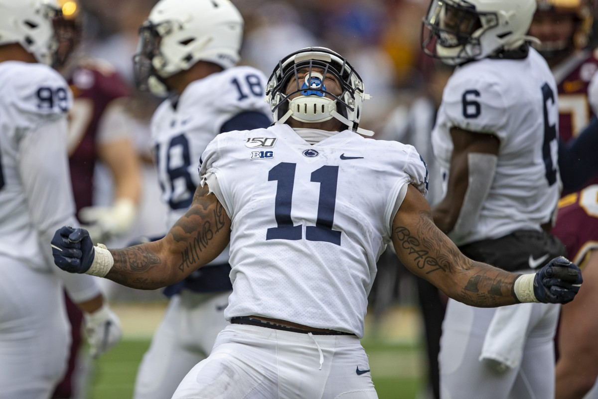 Penn State Nittany Lions linebacker Micah Parsons (11) celebrates after sacking the Minnesota Golden Gophers quarterback Tanner Morgan (not pictured) in the second half at TCF Bank Stadium.