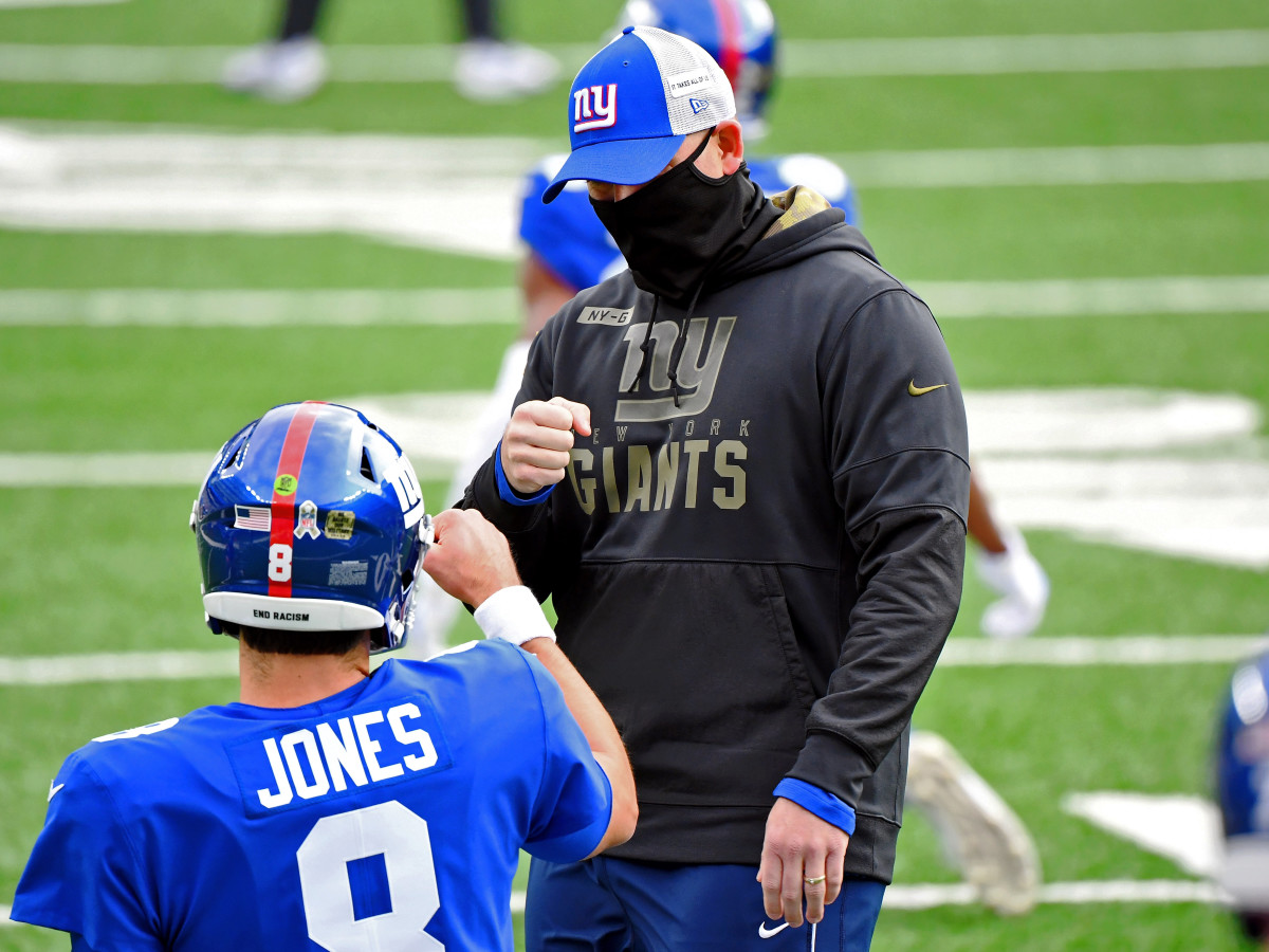 Nov 15, 2020; East Rutherford, New Jersey, USA; New York Giants head coach Joe Judge fist bumps quarterback Daniel Jones (8) before their game against the Philadelphia Eagles at MetLife Stadium.