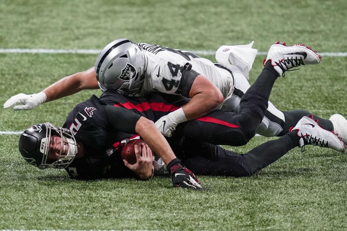 Las Vegas Raiders linebacker Nick Kwiatkoski (44) sacks Atlanta Falcons quarterback Matt Ryan (2) during the first half at Mercedes-Benz Stadium.