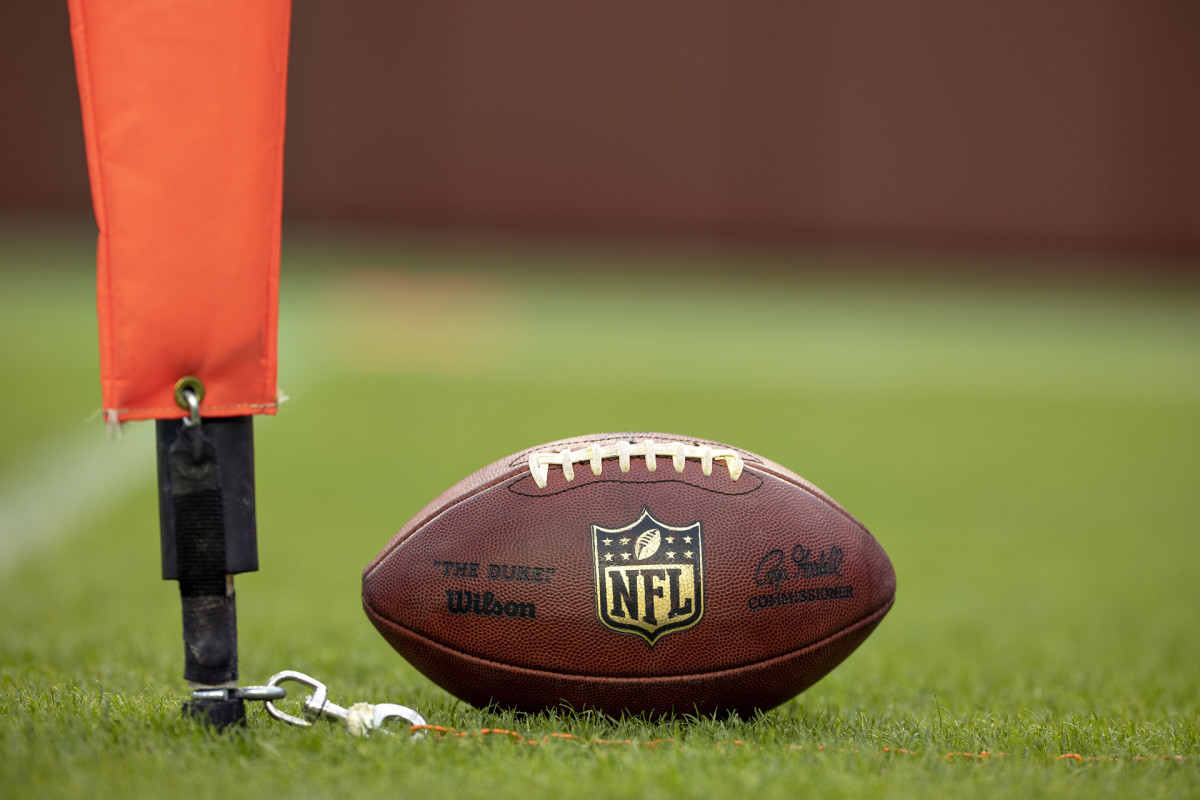NFL down marker being used for a measurement