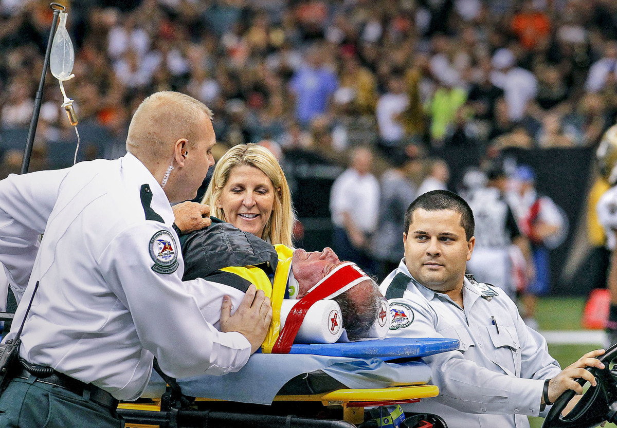 NFL chain crew member is carted off the field after suffering an injury in a collision