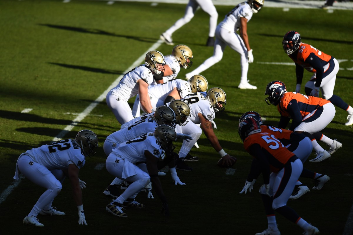 Nov 29, 2020; Denver, Colorado, USA; New Orleans Saints quarterback Taysom Hill (7) waits for the snap against the Denver Broncos at the line of scrimmage in the first quarter at Empower Field at Mile High. Mandatory Credit: Ron Chenoy-USA TODAY Sports