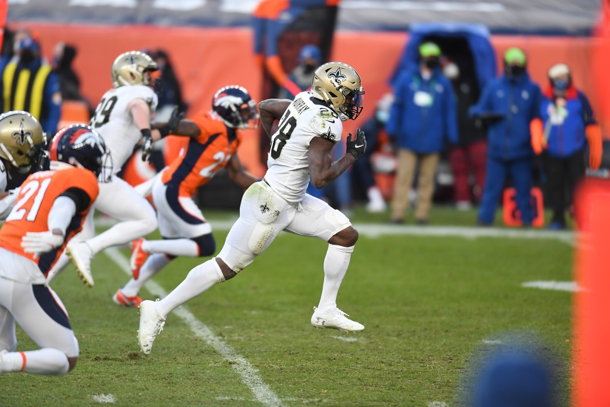 Nov 29, 2020; Denver, Colorado, USA; New Orleans Saints running back Latavius Murray (28) runs for a touchdown carry in the third quarter against the Denver Broncos at Empower Field at Mile High. Mandatory Credit: Ron Chenoy-USA TODAY