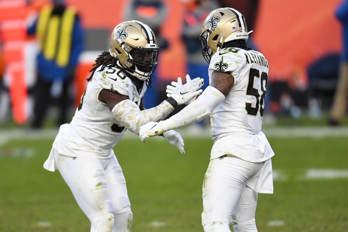 Nov 29, 2020; Denver, Colorado, USA; New Orleans Saints outside linebacker Demario Davis (56) and outside linebacker Kwon Alexander (58) celebrate a play against the Denver Broncos at Empower Field at Mile High. Mandatory Credit: Ron Chenoy-USA TODAY