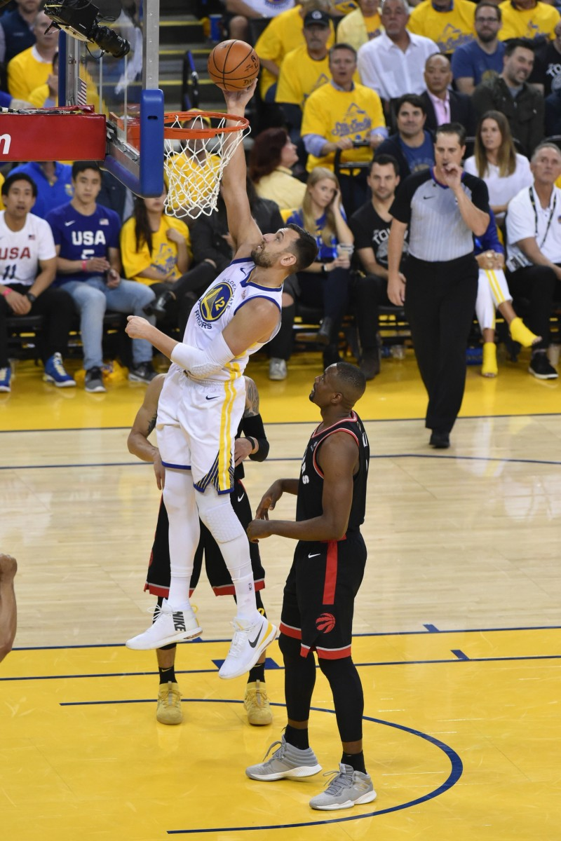 June 5, 2019; Oakland, CA, USA; Golden State Warriors center Andrew Bogut (12) shoots the basketball against Toronto Raptors center Serge Ibaka (9) during the first half in game three of the 2019 NBA Finals at Oracle Arena. The Raptors defeated the Warriors 123-109 to lead the series 2-1.