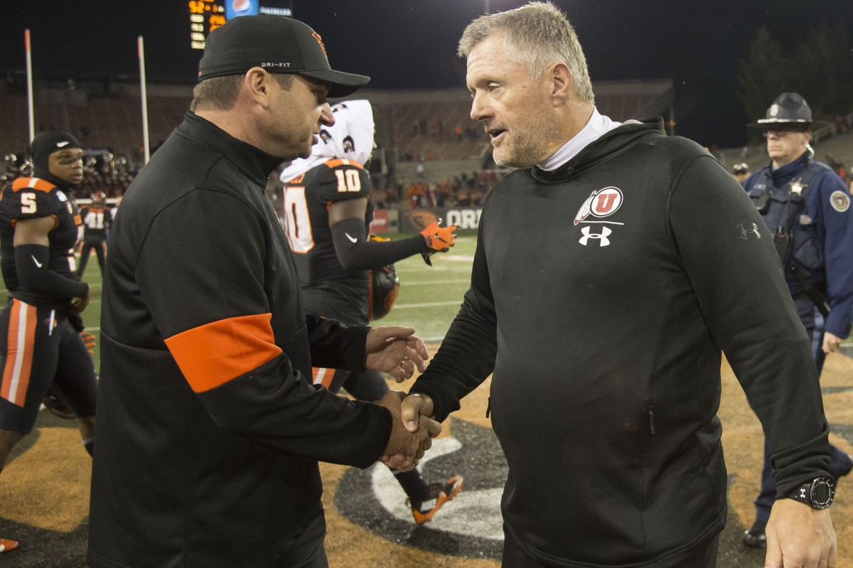 Oct 12, 2019; Corvallis, OR, USA; Oregon State Beavers head coach Jonathan Smith congratulates Utah Utes head coach Kyle Whittingham after a game at Reser Stadium. The Utes beat the Beavers 52-7.