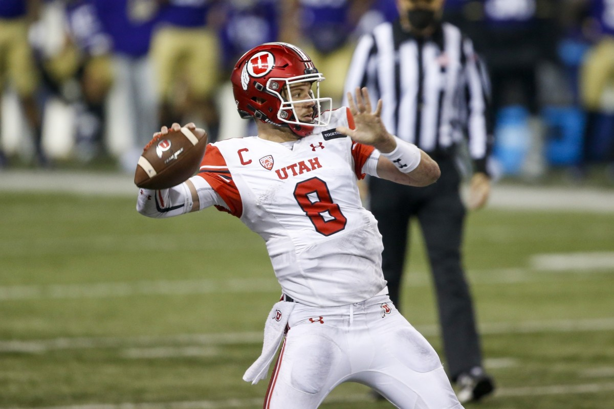 Nov 28, 2020; Seattle, Washington, USA; Utah Utes quarterback Jake Bentley (8) passes for a touchdown against the Washington Huskies during the second quarter at Alaska Airlines Field at Husky Stadium.