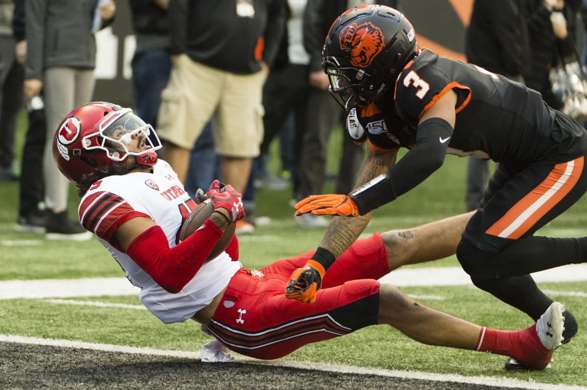 Oct 12, 2019; Corvallis, OR, USA; Utah Utes wide receiver Samson Nacua (45) catches a pass for a touchdown against Oregon State Beavers defensive back Jaydon Grant (3) during the first half at Reser Stadium.