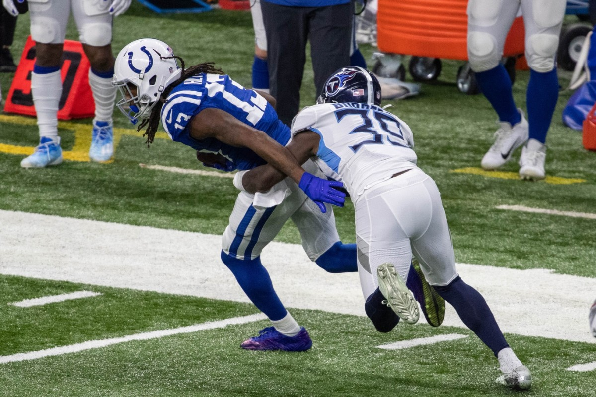Indianapolis Colts wide receiver T.Y. Hilton looks to run after a catch in Sunday's home loss to the Tennessee Titans.
