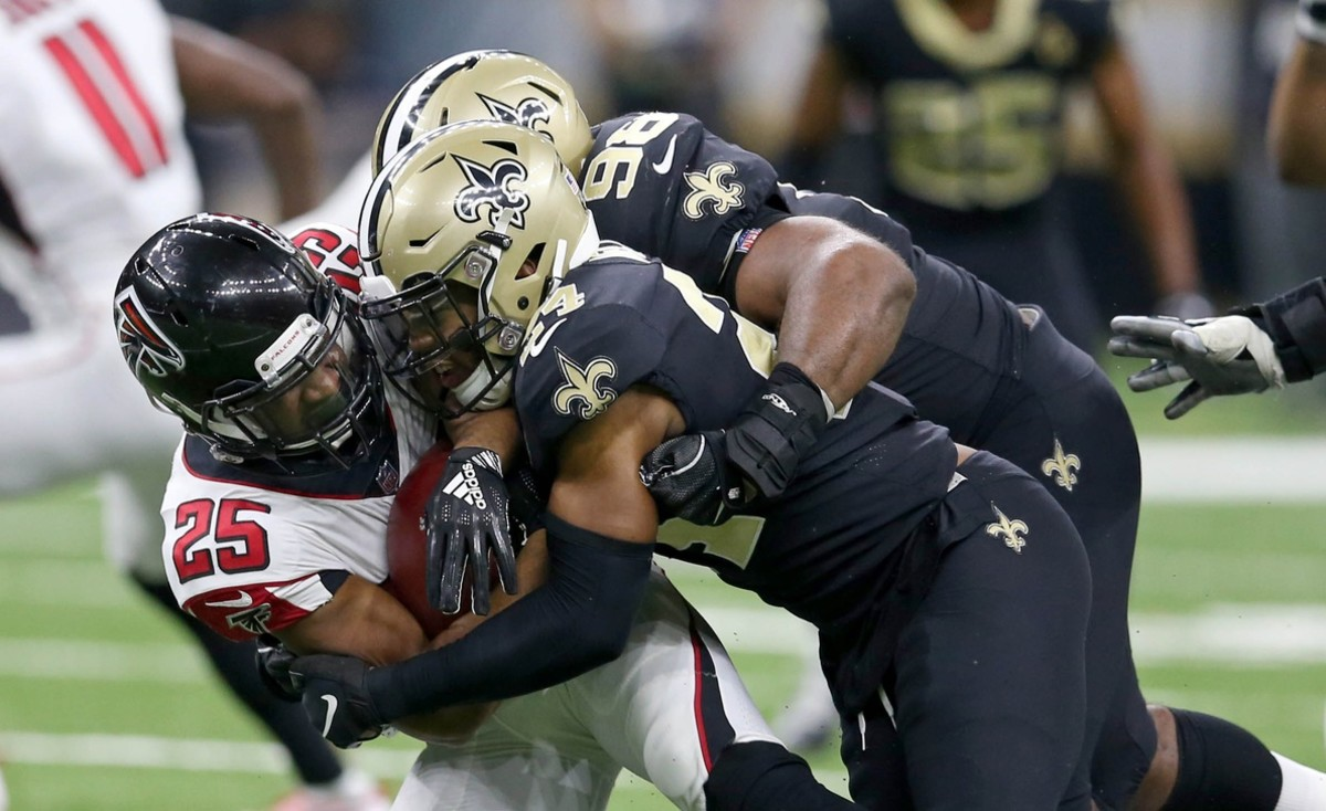 Nov 22, 2018; New Orleans, LA, USA; Atlanta Falcons running back Ito Smith (25) is tackled by New Orleans Saints defensive tackle Sheldon Rankins (98) in the second half at the Mercedes-Benz Superdome. Mandatory Credit: Chuck Cook-USA TODAY