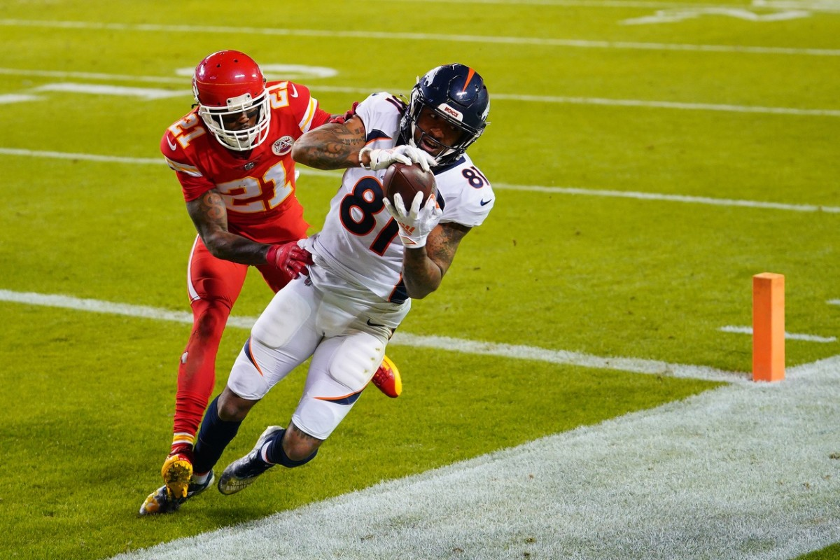 Denver Broncos wide receiver Tim Patrick (81) catches a touchdown pass while defended by Kansas City Chiefs cornerback Bashaud Breeland (21) during the second half at Arrowhead Stadium.s
