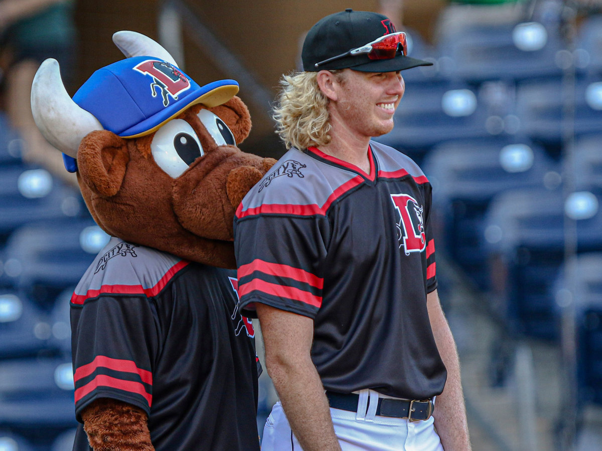 Sam McWilliams stands with a mascot