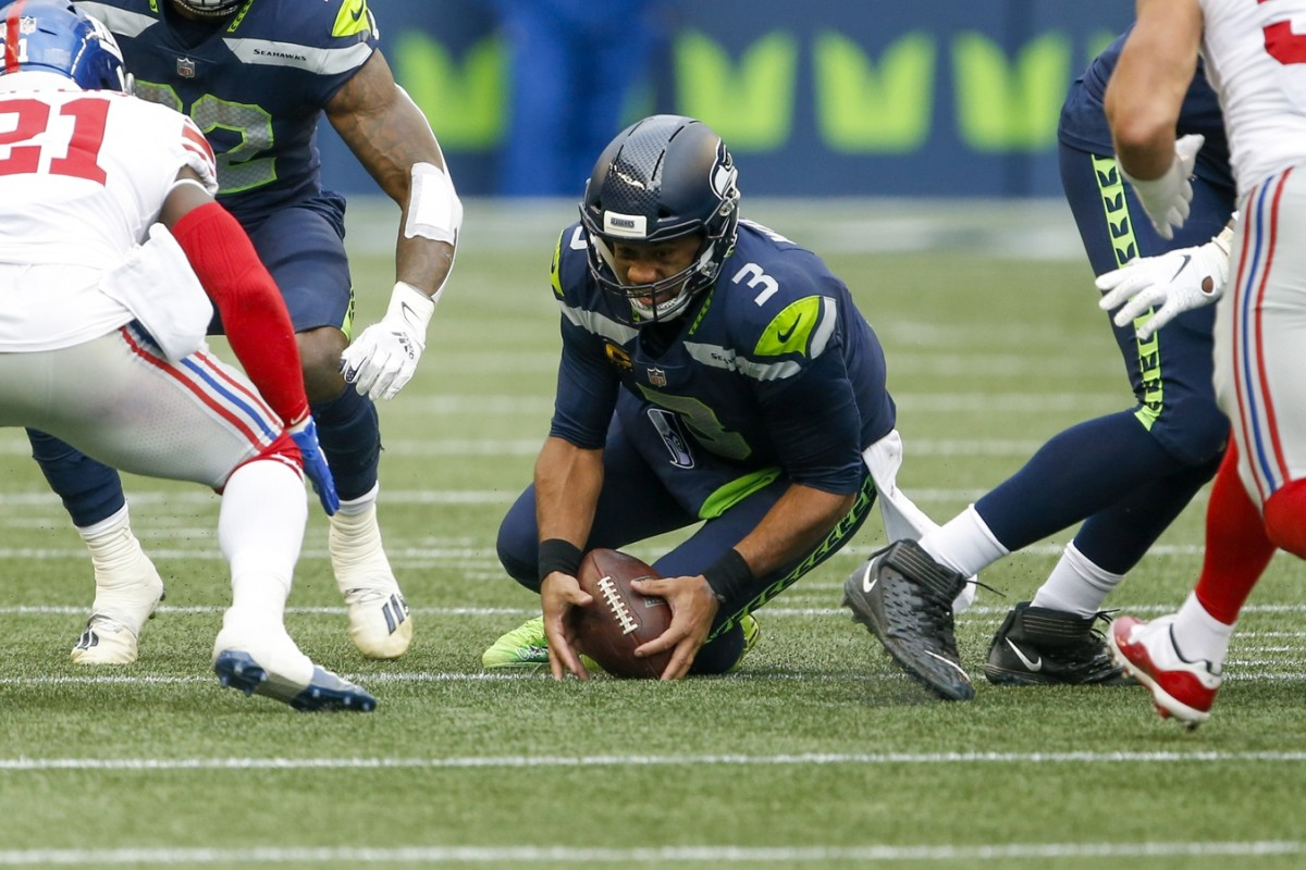 Dec 6, 2020; Seattle, Washington, USA; Seattle Seahawks quarterback Russell Wilson (3) fumbles against the New York Giants during the second quarter at Lumen Field.