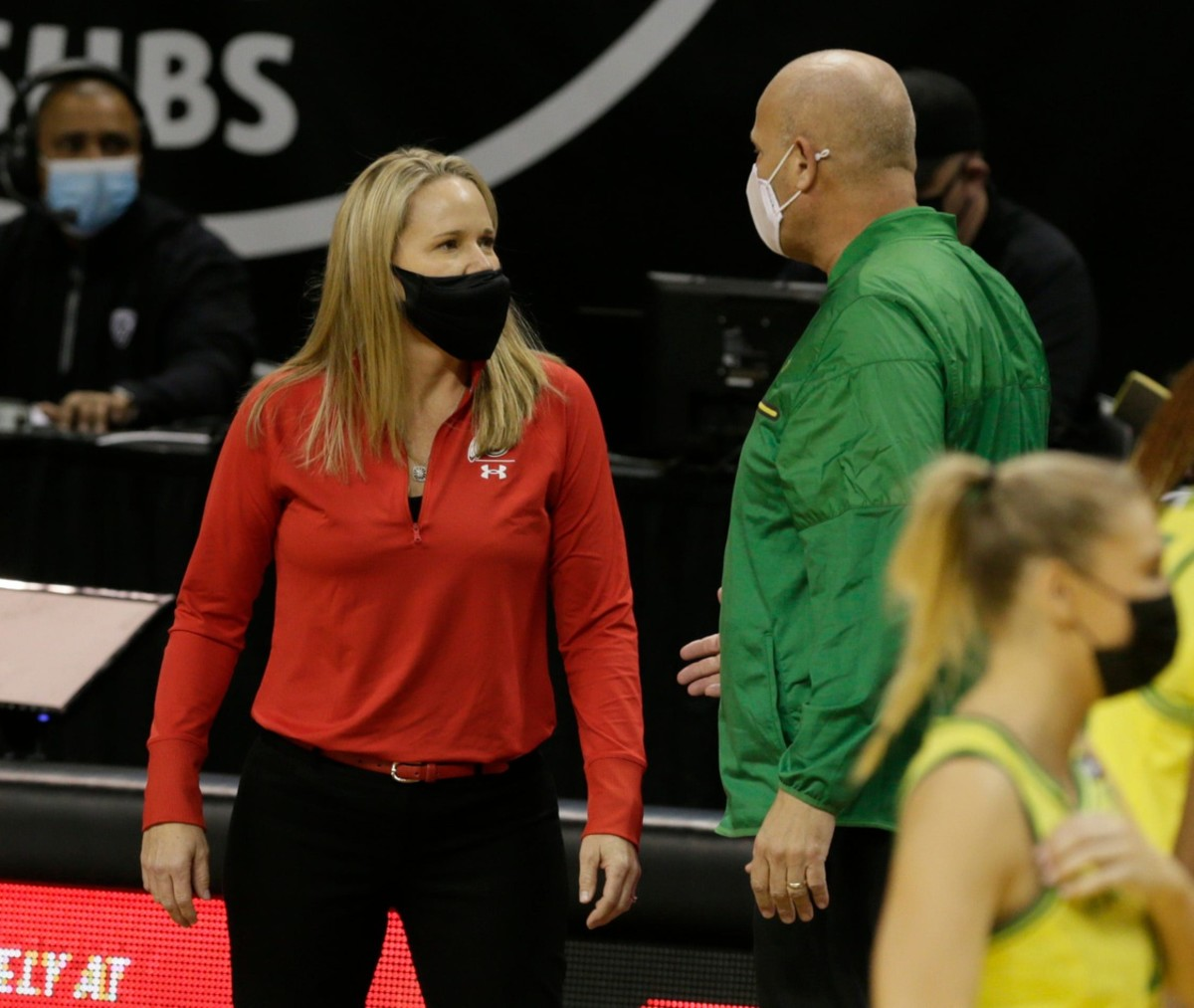 Utah head coach Lynne Roberts speaks with Oregon head coach Kelly Graves prior to the start of the Oregon-Utah game on Sunday, Dec. 6 — © Chris Pietsch/The Register-Guard via Imagn Content Services, LLC
