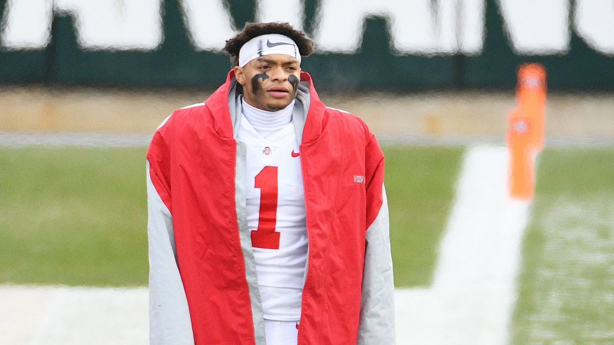 Ohio State QB Justin Fields watches from the sidelines during a game vs. Michigan State