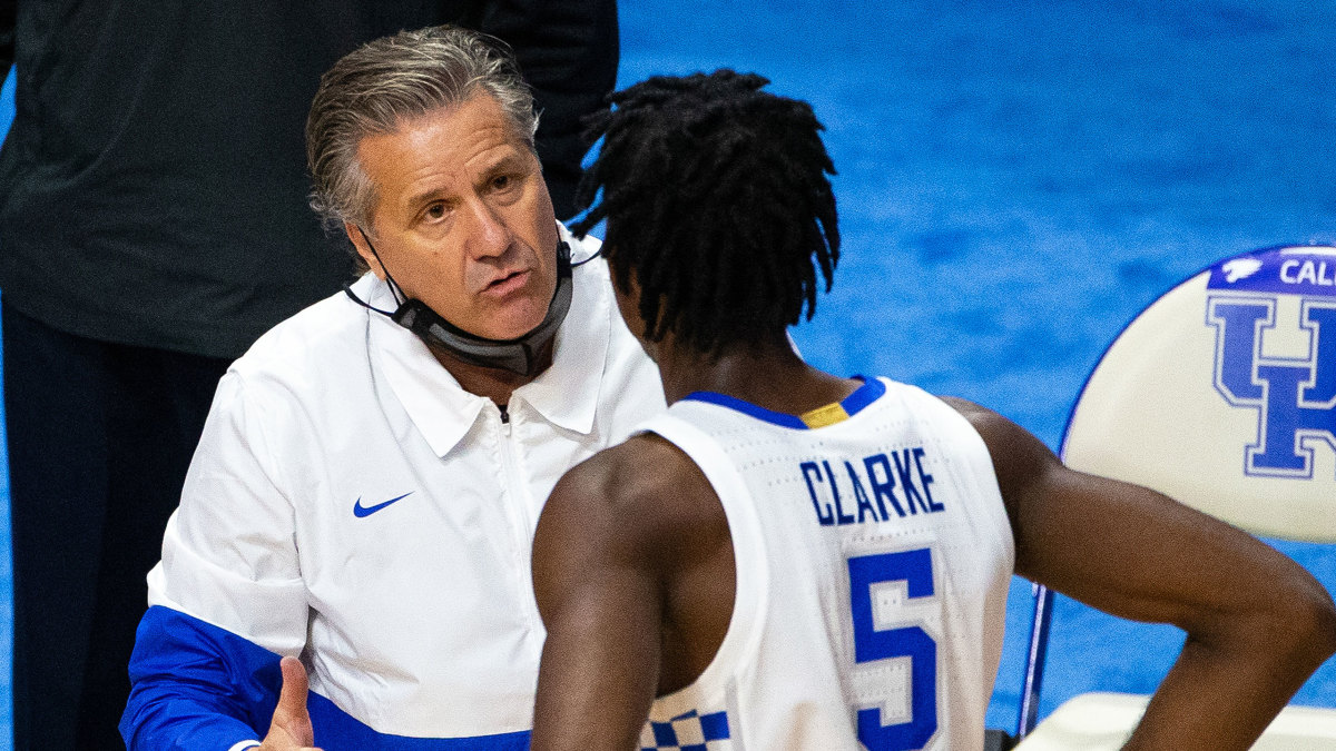 Kentucky coach John Calipari speaks to a player