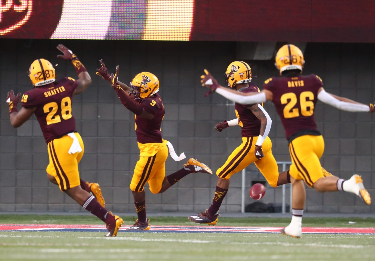 Dec 11, 2020; Tucson, Arizona, USA; Arizona State Sun Devils running back Demetrious Flowers (9) celebrates after returning the opening kickoff for a touchdown against the Arizona Wildcats during the Territorial Cup at Arizona Stadium.