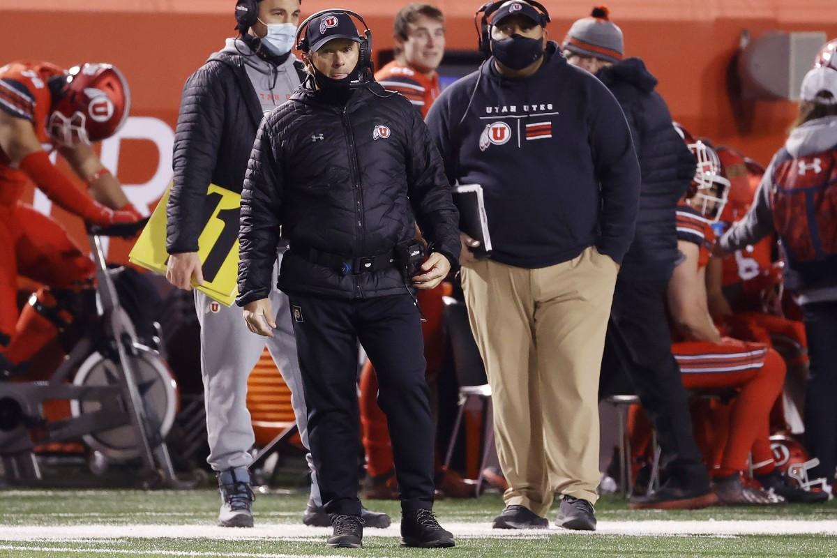 Dec 5, 2020; Salt Lake City, Utah, USA; Utah Utes head coach Kyle Whittingham keeps an eye on the action during their game against the Oregon State Beavers at Rice-Eccles Stadium.