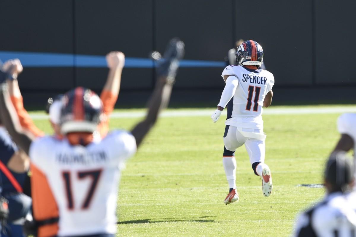 Denver Broncos punt returner Spencer (11) returns a punt for a touchdown in the first quarter at Bank of America Stadium.