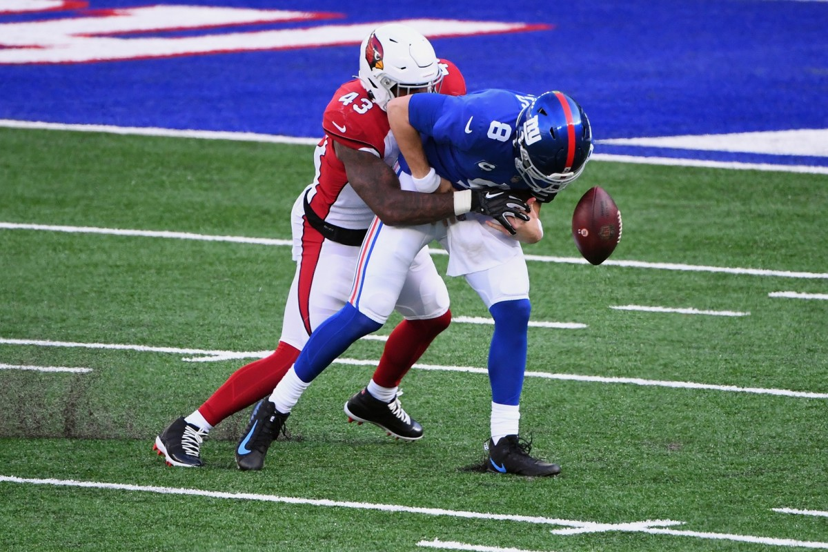 Arizona Cardinals linebacker Haason Reddick (43) forces a fumble by New York Giants quarterback Daniel Jones (8) during the first half at MetLife Stadium. Jones recovered the ball.