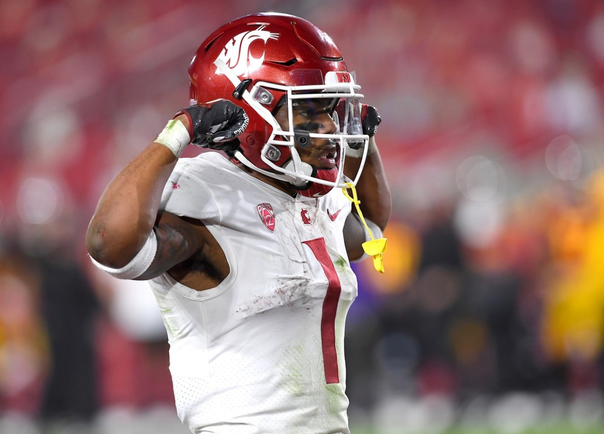 Dec 6, 2020; Los Angeles, California, USA; Washington State Cougars running back Deon McIntosh (3) celebrates after scoring a touchdown in the first half of the game against the USC Trojans at United Airlines Field at the Los Angeles Memorial Coliseum.