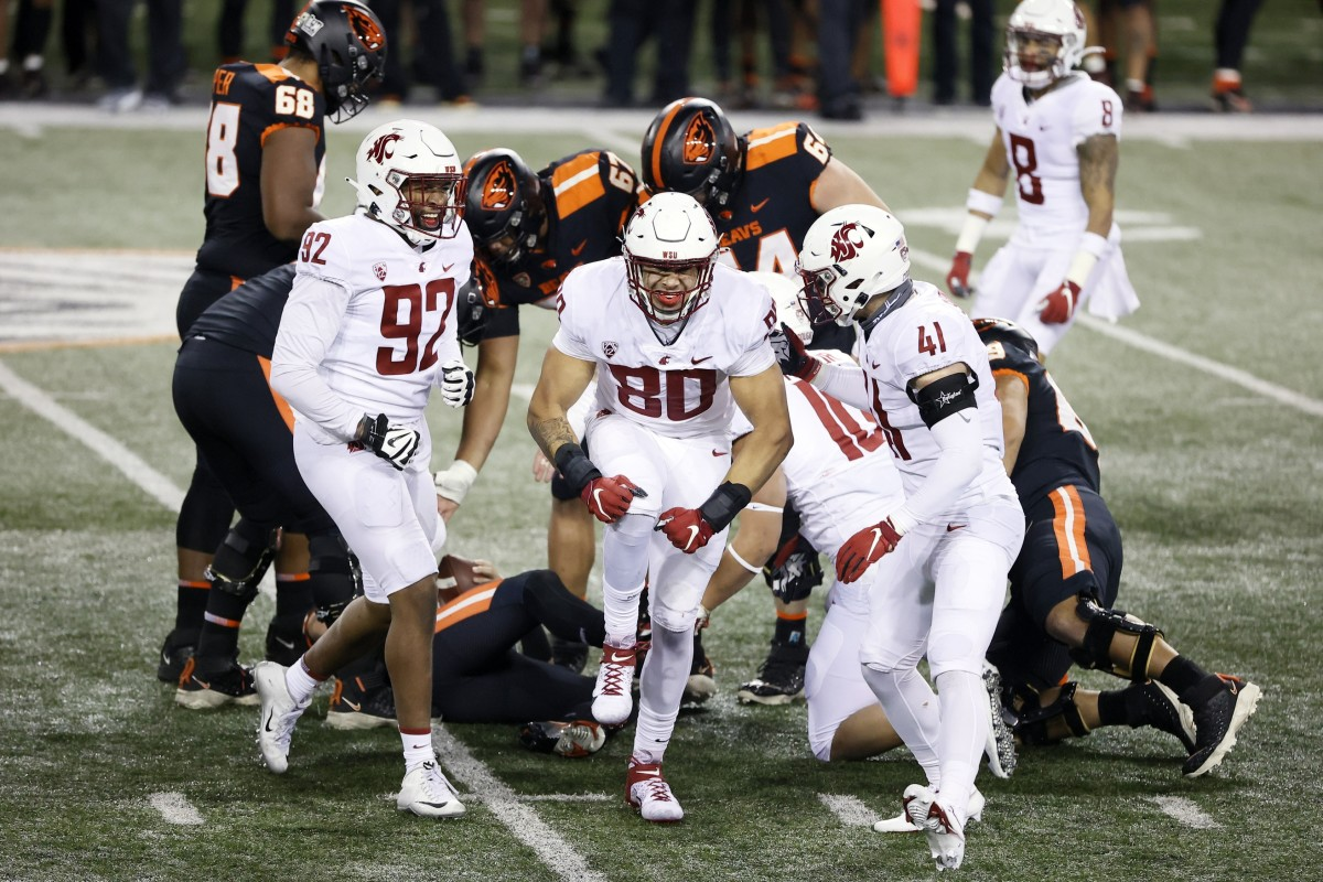 Nov 7, 2020; Corvallis, Oregon, USA; Washington State Cougars defensive end Brennan Jackson (80) celebrates with Dillon Sherman (41) and Will Rodgers III (92) after sacking Oregon State Beavers quarterback Tristan Gebbia (3) during the first half at Reser Stadium.