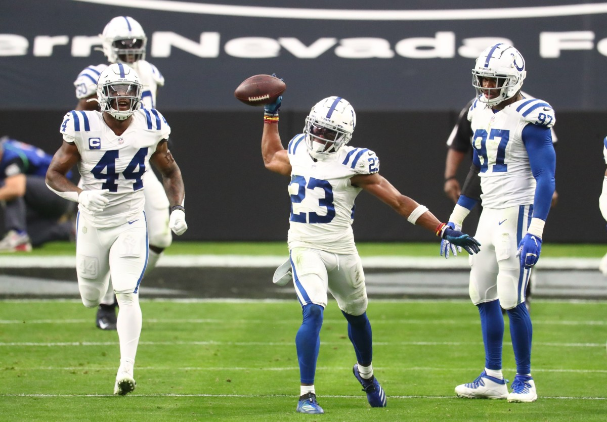 Indianapolis Colts cornerback Kenny Moore II spikes the football after his one-handed interception in the second quarter of Sunday's win at Las Vegas.