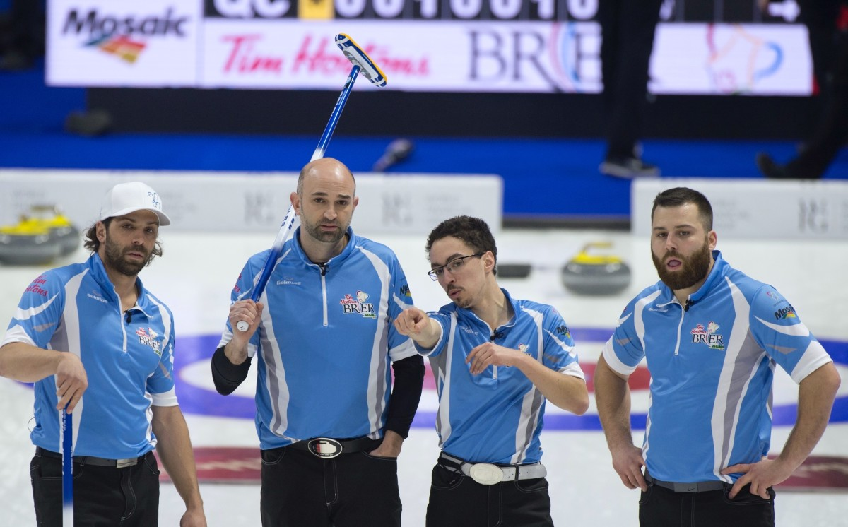 The author (second from left) at the 2018 Brier • Michael Burns-Curling Canada